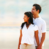 Couple breathing fresh air at the beach poster