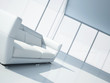 modern white leather sofa in a light interior