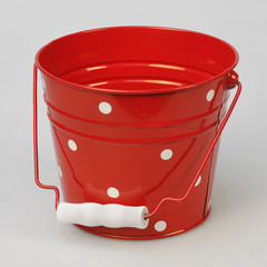 red bucket with white dots