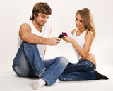 Beautiful couple with mobile phones