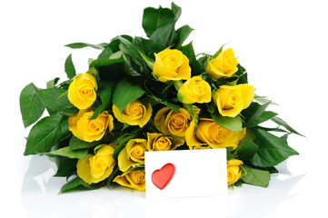 yellow roses and a valentine card isolated on white