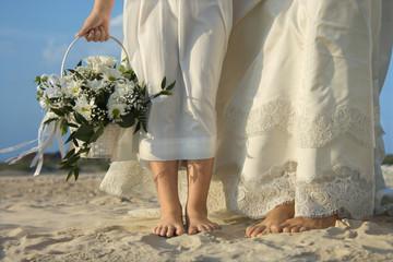 Bride and Flower Girl on Beach