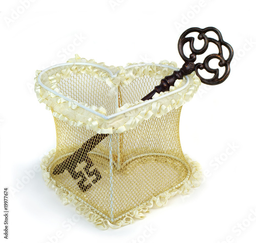 Wedding heart with rusty key. Isolated over white background