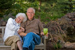 Elderly man and woman sitting on a bench