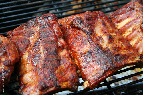 Barbecue pork ribs on a grill - 19983631