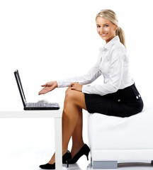 Business woman displaying a laptop computer - isolated over a w