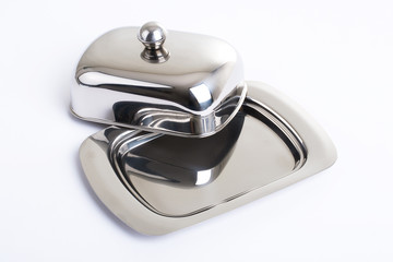 Stainless butterdish on a white background