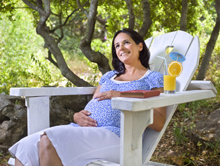 pregnant woman in an Adirondack chair