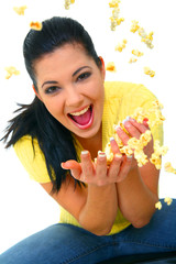 Pretty Young Girl Throwing Popcorn