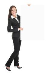 Businesswoman holding empty billboard sign