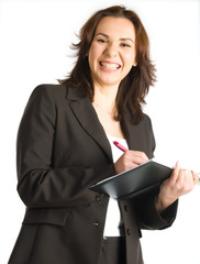 laughing businesswoman writing in notepad