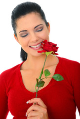 attractive woman smelling red rose smiling. isolated on white