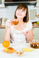 Young beautiful happy woman with tea
