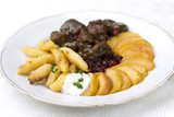 meat stew with dumplings, cranberries & caramelized apple