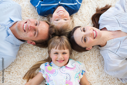 Smiling Family lying in a circle