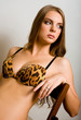 Lovely woman in leopard lingerie