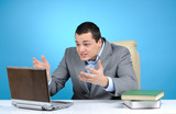 Businessman playing video game at working hours poster