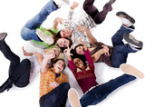 Group of carefree teenagers lie poster