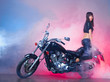 Beautiful girl on a retro motorcycle i smoke cloud