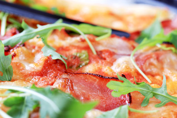 Slices of proscuitto on pizza