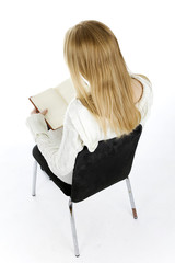 sitting on the chair young woman reading book