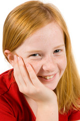 portrait of an adorable young girl with her hand on cheek on whi