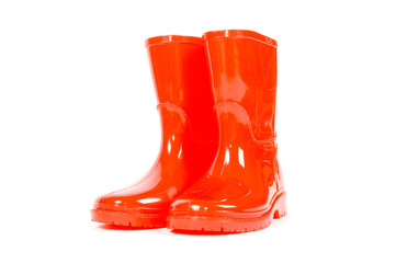 Red children rain boots on a white background
