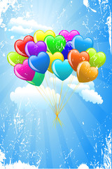 Bunch of colorful cartoon heart balloons on blue sky background