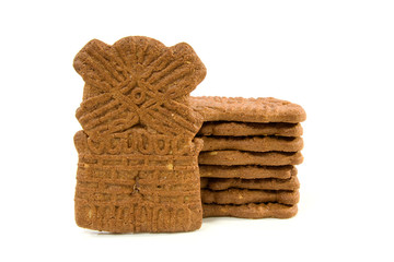Dutch speculaas biscuit cake over white background