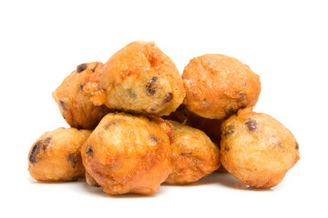 Pile of Dutch donut also known as oliebollen over white