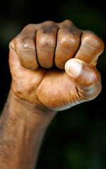 clenched fist of afro man