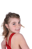 pretty young girl in red leotard looking over her shoulder
