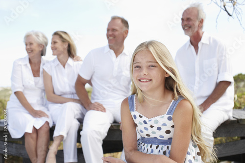 Girl with her parents and grandparents
