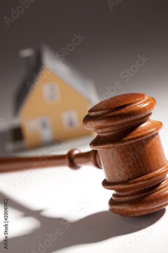 Gavel and Model Home on Gradated Background