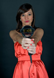 Hairdryer gun holding by a woman poster