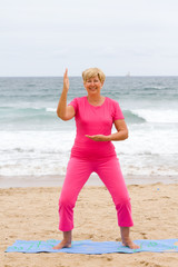 senior woman doing tai chi