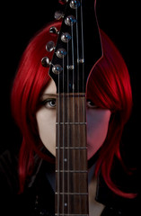 Portrait of gothic girl with guitar