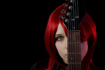 Gothic girl wearing scary lenses with guitar