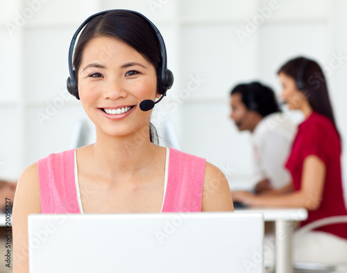 Asian Businesswoman using headset
