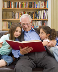 grandfather reading a story to his grandchild