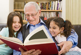 senior and children reading