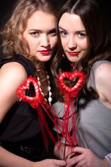 Two beautiful girls celebrate Valentine's Day