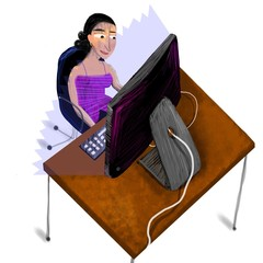 Woman seated in front of the computer