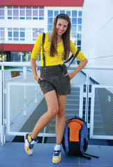 teen girl in front of school