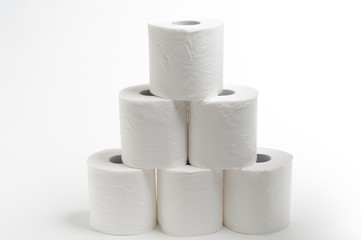 Pile of 6 Toilet paper stacked on top of each other