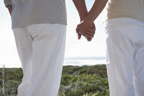 Couple holding hands