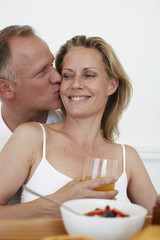 Man kisses his wife
