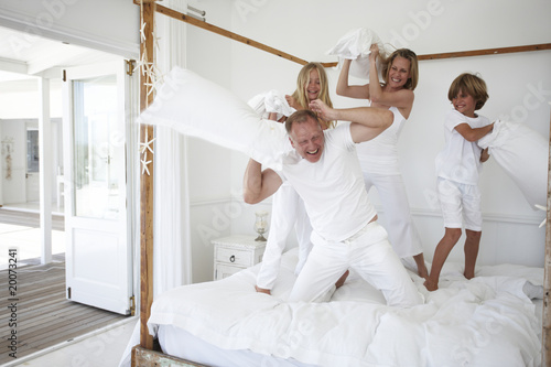 Family pillow fighting