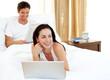Charismatic woman using laptop