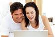 Romantic couple using laptop